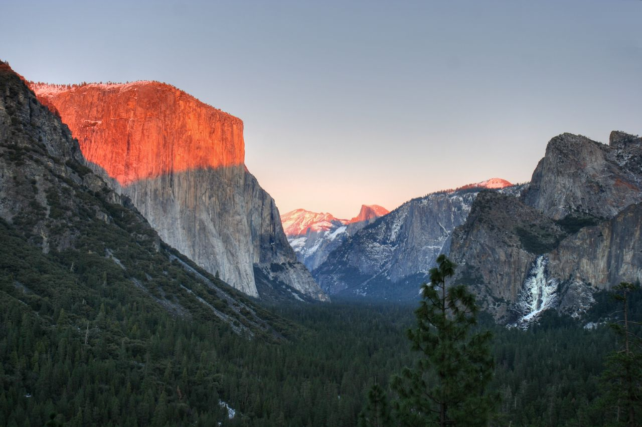 Looking up Yosemite Valley from Highway 41 at Sunset, El Capitan on the left and Bridal Veil on the right