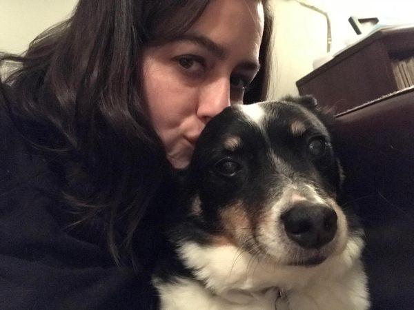Lady smooching her dog