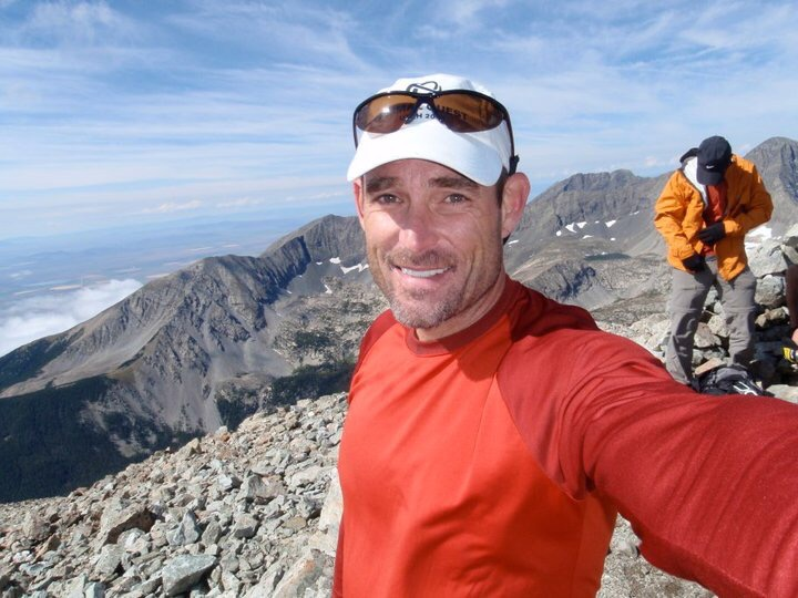 David Boyd on top of a mountain, smiling