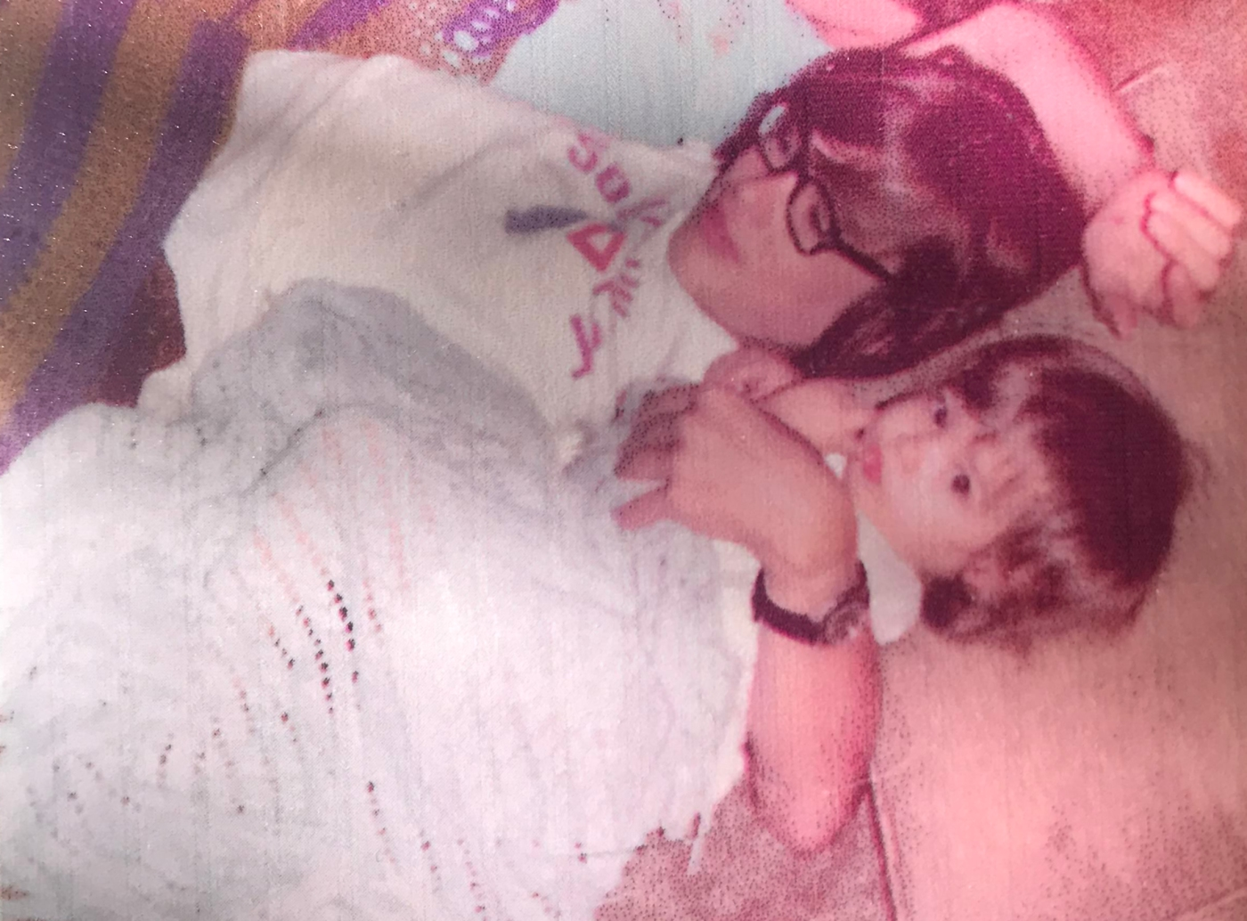 My brother David at about 13 with him arm around me, about one